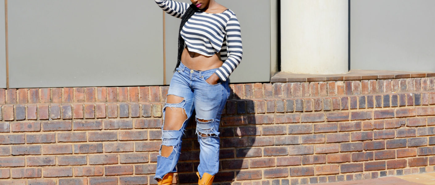 stylish crop tops and distressed jeans