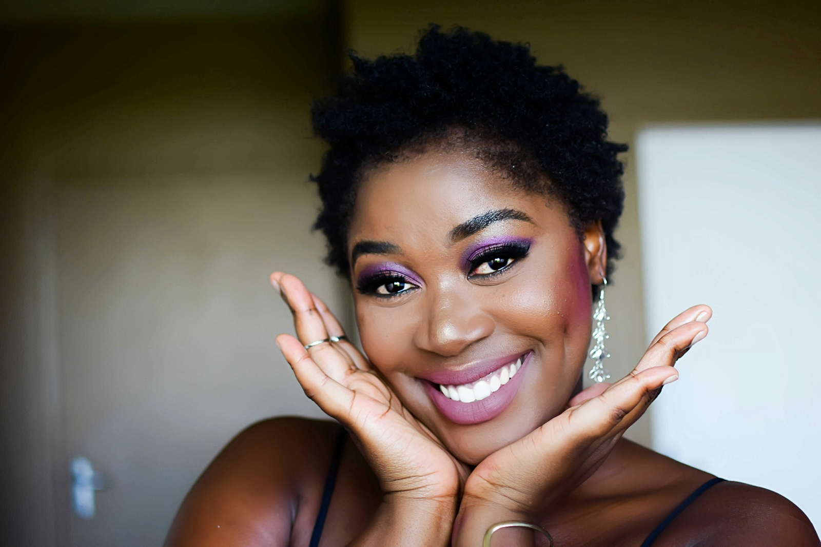 Purple eye shadow and growing afro hair essentials (1)