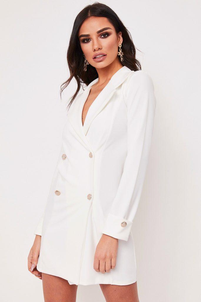 White blazer dresses Miss Pap.