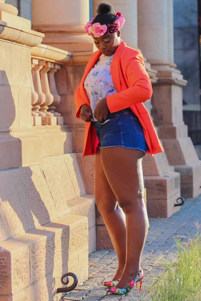 orange jacket denim shorts