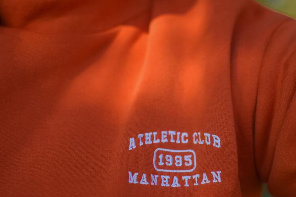 Orange track pants athletic Club Manhattan